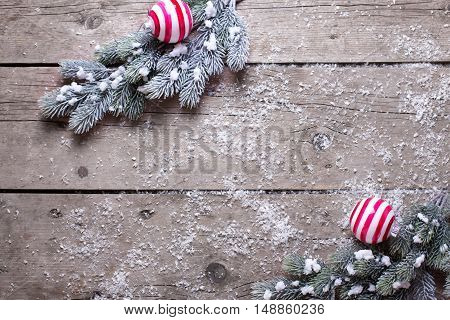 Christmas balls and branches fur tree on aged wooden background. Decorative christmas composition. Selective focus. Place for text.