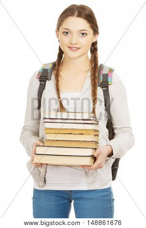 Beautiful teenager with backpack and books.