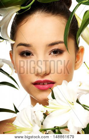 Beauty face of a woman with flowers.