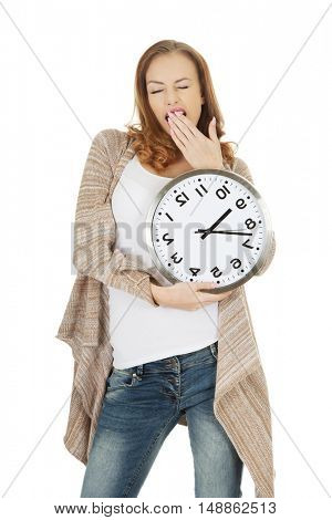 Tired woman with clock.