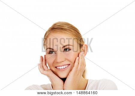Young happy woman holding both hands on cheeks
