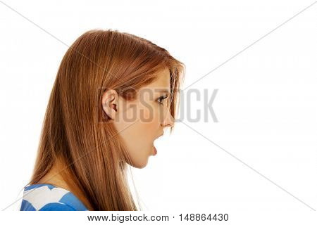 Angry young woman screaming for someone