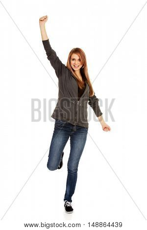 Teenage woman with hand up
