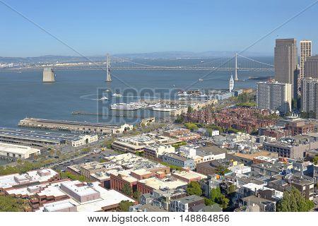 San Francisco California Embarcadero blvd. piers and the Bay bridge.
