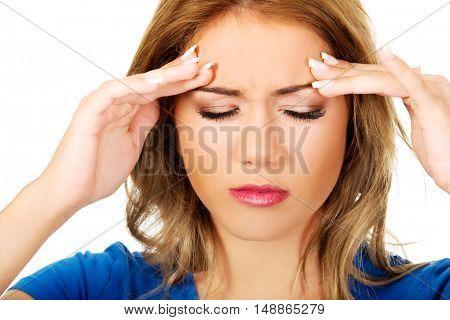 Young woman with headache.