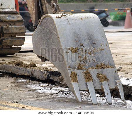 Large Backhoe At Work