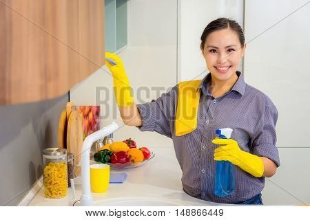 Young beautiful asian woman housekeeping in the kitchen