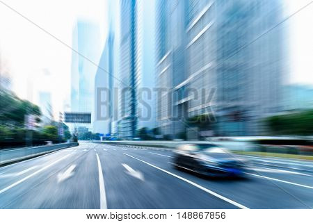 cars driving on inner city road of shanghai,china,asia.