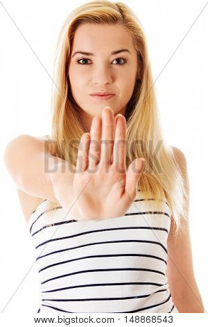 Young woman making stop sign on white background.