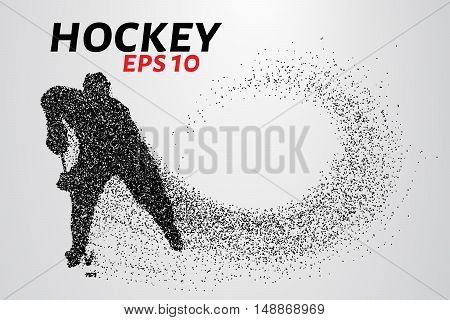 Hockey player of the particles. Silhouette of a hockey player consists of small balls and scatters in the wind. Vector image