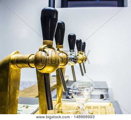 beer taps array vintage style. white wall