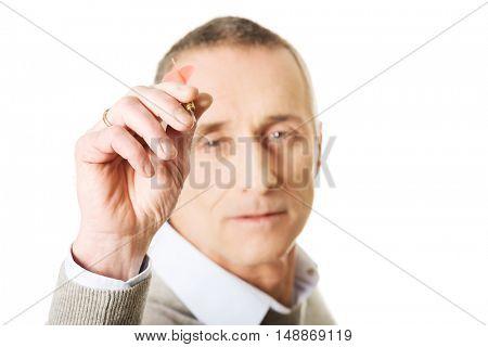 Mature man playing darts