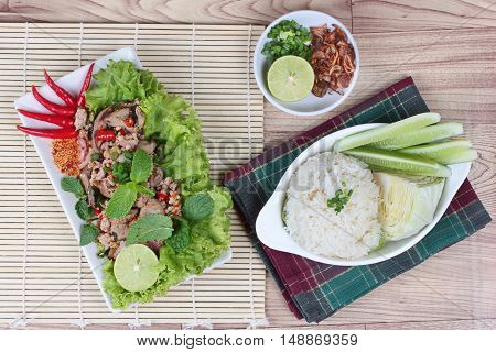 Sticky rice with spicy sour mixed herb salad of chicken and liver pork
