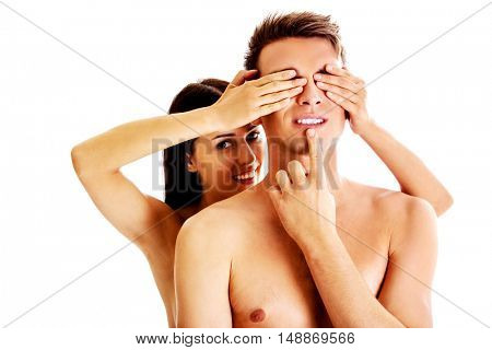 Girlfriend covering the eyes of her boyfriend for a surprise - isolated