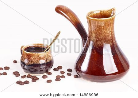 Cup of coffee with a coffee pot