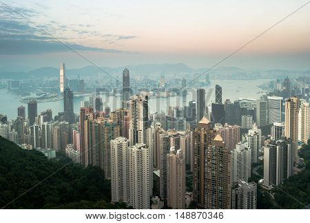 Skyscrapers of Hong Kong in China, Asia. Night view of the city life. Light of the buildings are very colorful, shining with warm tones.