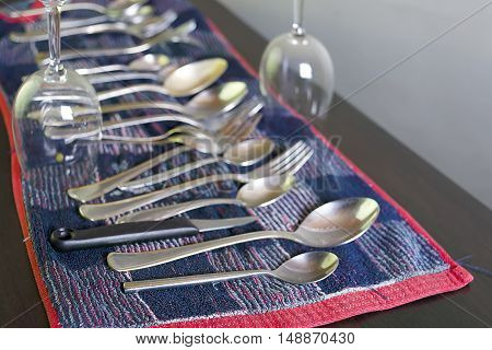 Various washed dishes laid on a kitchen towel focus in the foreground studio shot with a shallow depth of field
