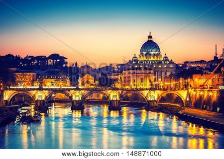 Night view of St. Peter's cathedral and Tiber river in Rome, Italy