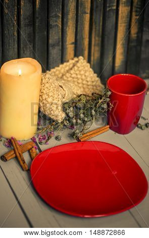 Composition With Candles And Red Utensils On Wooden Background