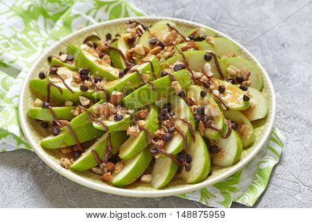 Loaded apple nachos with caramel, chocolate chips, granola and almonds