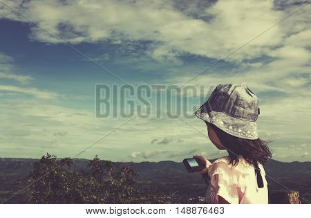 Side View Of Asian Girl Relaxing Outdoors In The Daytime, Travel On Vacation. Cream Tone.