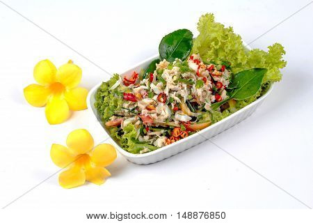 Spicy and sour mixed herb salad with crab is Thai cuisine as kaffir lime leaves,minced red chili,sliced shallots,parsley,lettuce and peppermint.