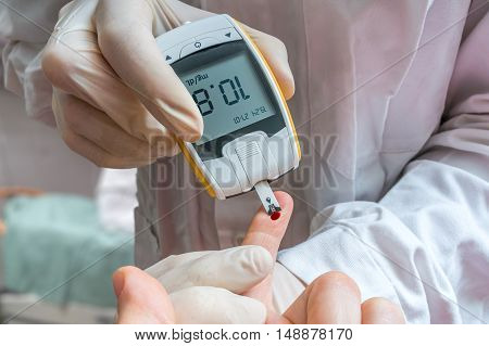 Diabetes Concept. Doctor Is Monitoring Blood Glucose Level Of Di