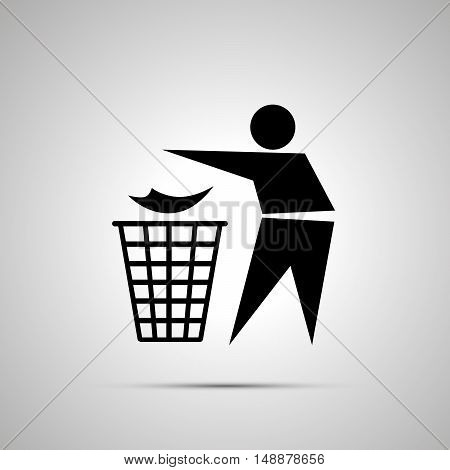 Man throwing garbage in the trash can simple black icon with shadow