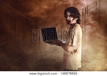 Horrible Male Zombies Standing Typing In Laptop Looking At Behind