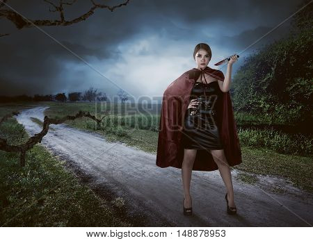 Portrait Of The Asian Witch Woman Holding Knife With Blood