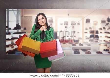 Young Pretty Asian Girl Standing In Front Of A Store