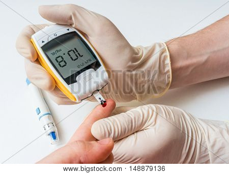 Doctor Is Measuring Glucose Level From Blood Of His Patient.