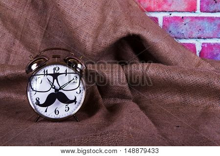 Alarm Clock With A Black Hipster Mustache