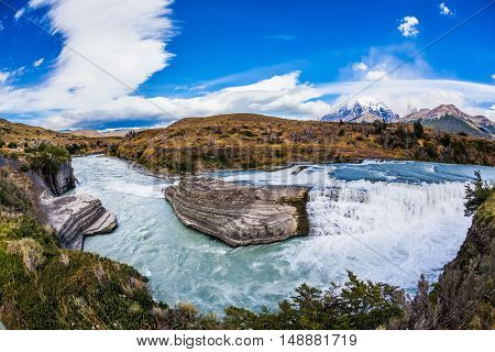 Chile, Patagonia, Paine Cascades. Emerald Paine river forms a cascading waterfalls. Torres del Paine National Park - Biosphere Reserve
