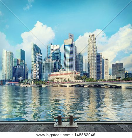 Singapore central quay with wooden pier on foreground