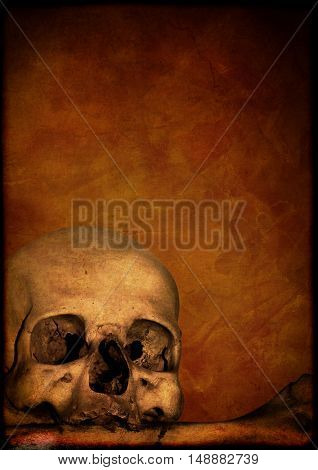 Grunge Halloween background with human skull and bone and stucco texture of brown color