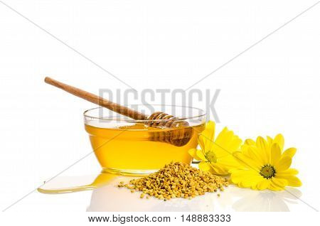 The Bowl Of Honey Near A Pile Of Pollen And Flower Isolated On White