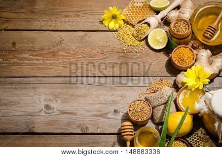 Honeycombs ,honey, Ginger, Pollen, Lemon On A Wooden Table