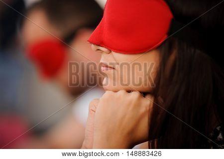 brunete girl in mask playing mafia game