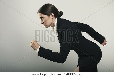 Beautiful young businesswomen passing run isolated photo