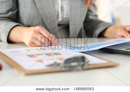 Businesswoman looking at graphics. Manager or auditor reading reports. Financial planning business analysis and project management concept.