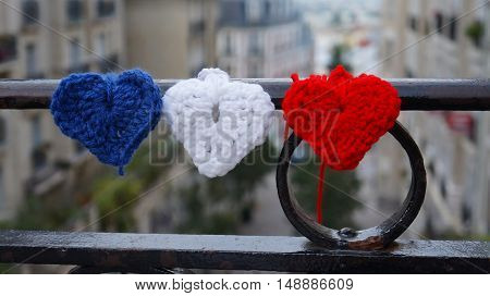 View through France flag tricolor at Montmartre streets