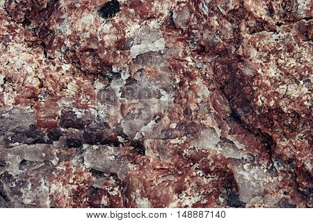 Surface of red granite close-up. Texture wild stone.