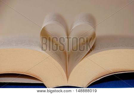 Love books.book pages in the shape of a heart. I like to read, reading.
