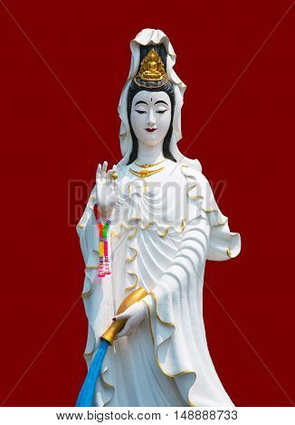 The marble Guan Yin on red Color in Chinese background with clipping path for other designs