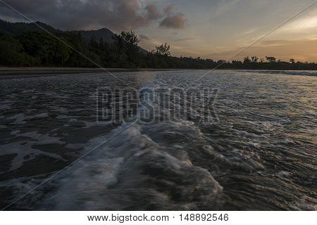 Scenery of Mount Sinambong Banggi Island during sunset from the beach Kapitangan Village , Banggi Island, Kudat Sabah, Malaysia. July 2016