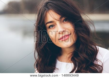 Beautiful smiling plump girl. Closeup portrait of gorgeous woman looking to camera
