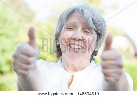 Old age woman showing thumbs up