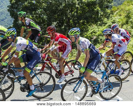 Col D'AspinFrance- July 15 2015: Cyclists form various teams climbing in the peloton the road to Col D'Aspin in Pyrenees Mountains during the stage 11 of Le Tour de France 2015.