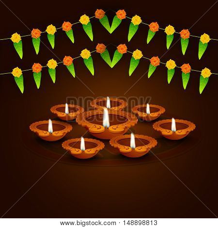 Creative Oil Lamps  on traditional mango leaves buntings decorated brown background for Indian Festival of Lights, Happy Diwali celebration.